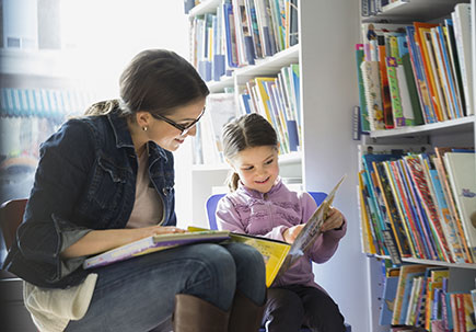 Woman and child reading together.